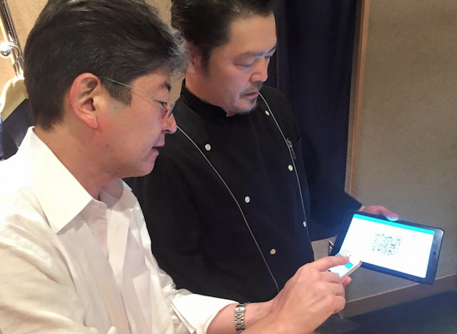 Oki Matsumoto Paying with Bitcoin